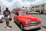 Weller paying taxi in Cuba